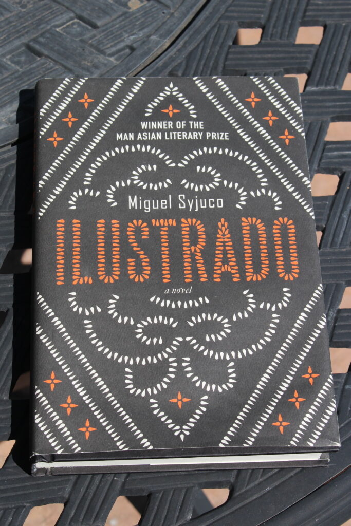 Cover of Ilustrado shows a design in white and orange on black