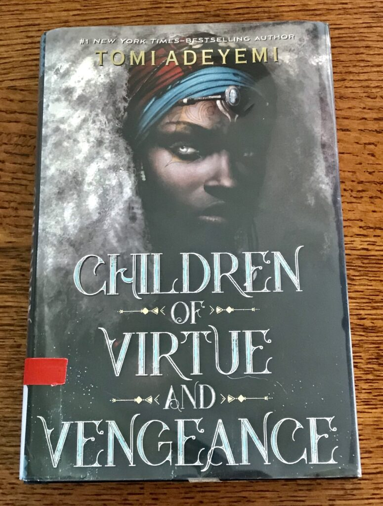 The cover of Children of Virtue and Vengeance shows a black woman with white hair and gold tattoos